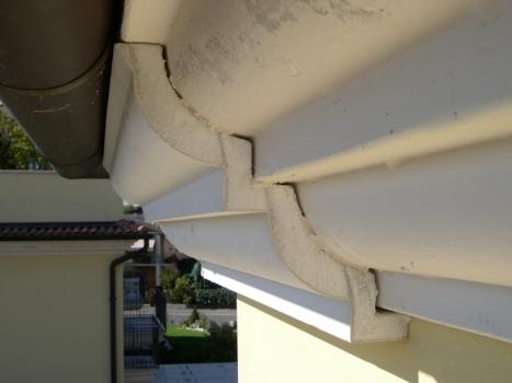 Cappotto a cornice in cemento realizzato con sagoma in EPS ad alta densità e trattata con resina cementizia